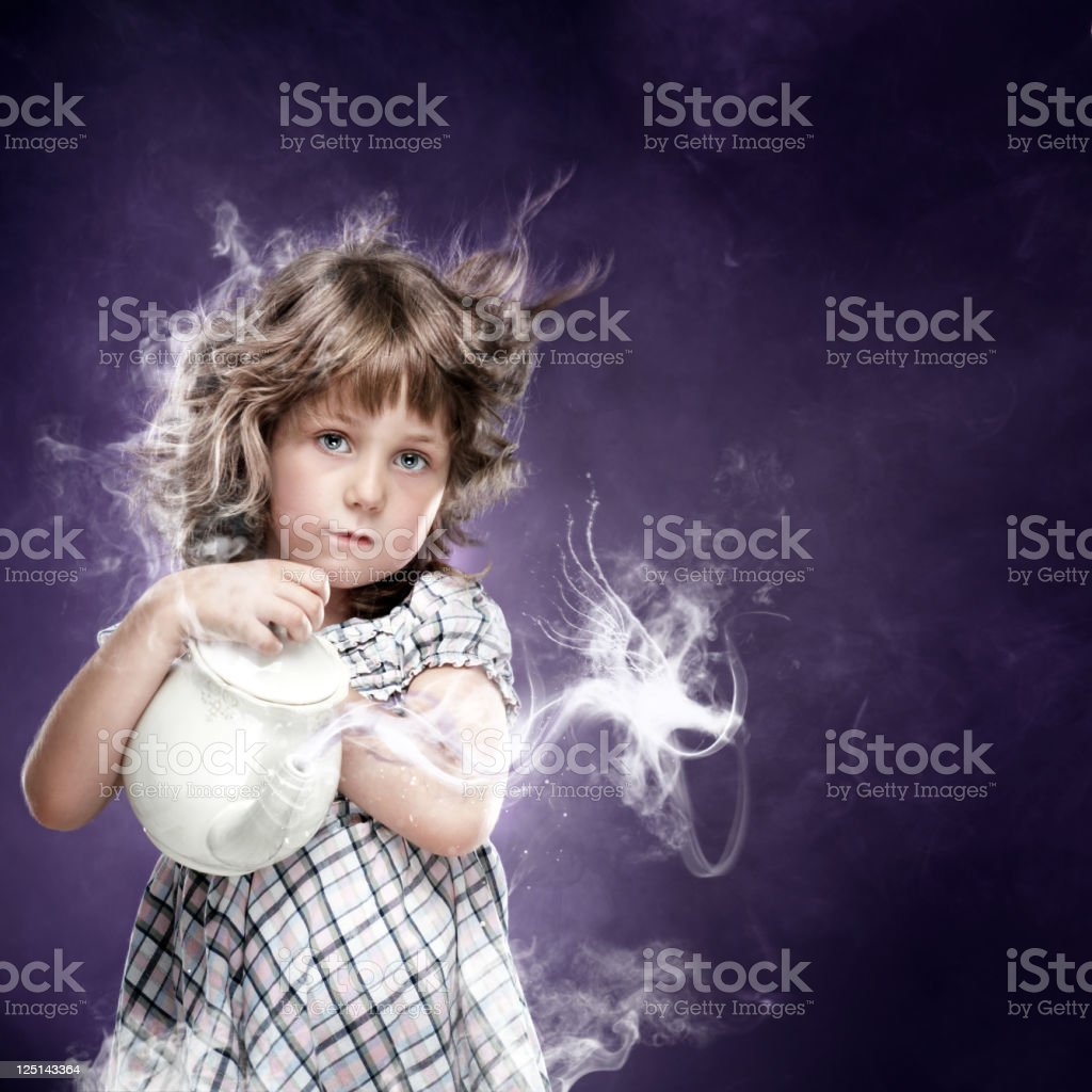 Little girl and her magic pitcher stock photo