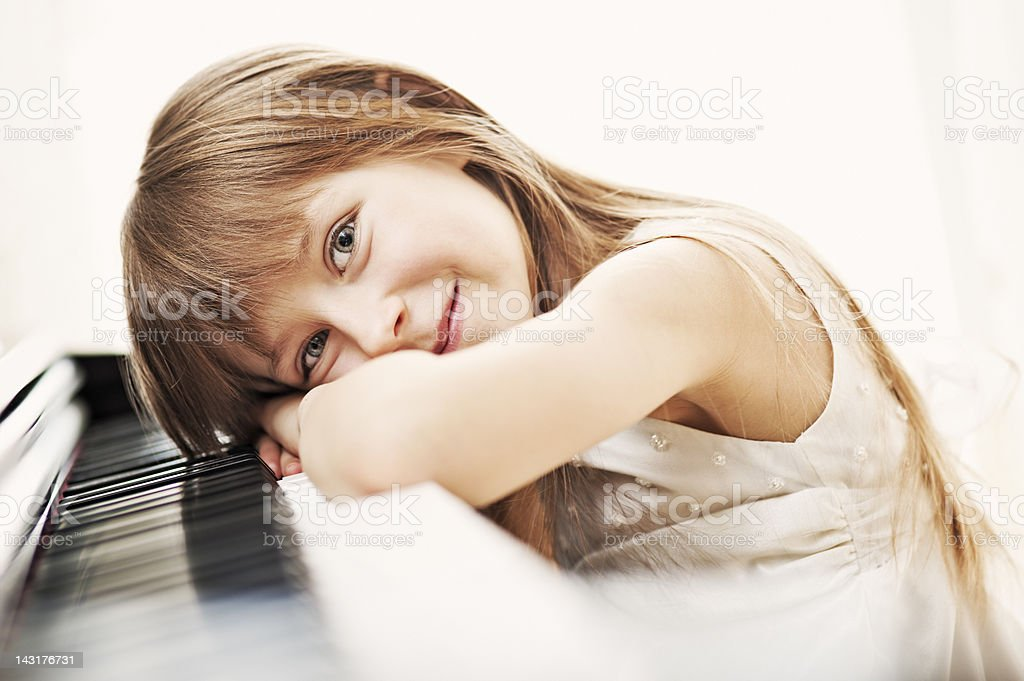 Little girl and her piano royalty-free stock photo