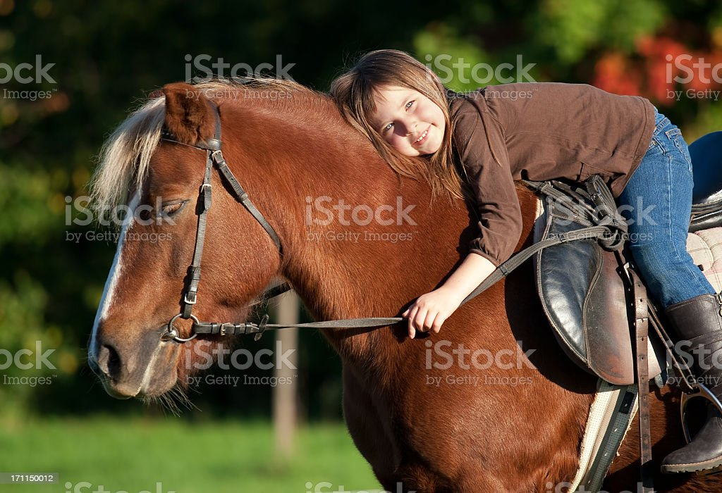 Little girl and her pony stock photo