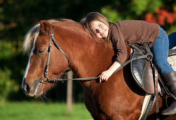 Little girl and her pony happy little girl and her pony pony stock pictures, royalty-free photos & images