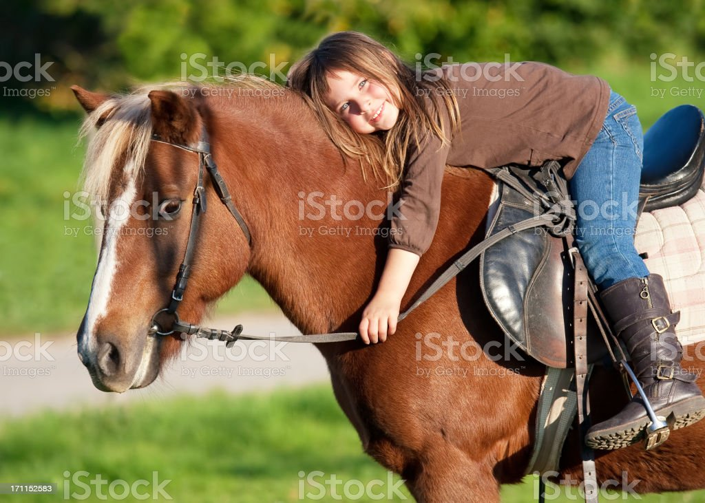 Little girl and her pony royalty-free stock photo