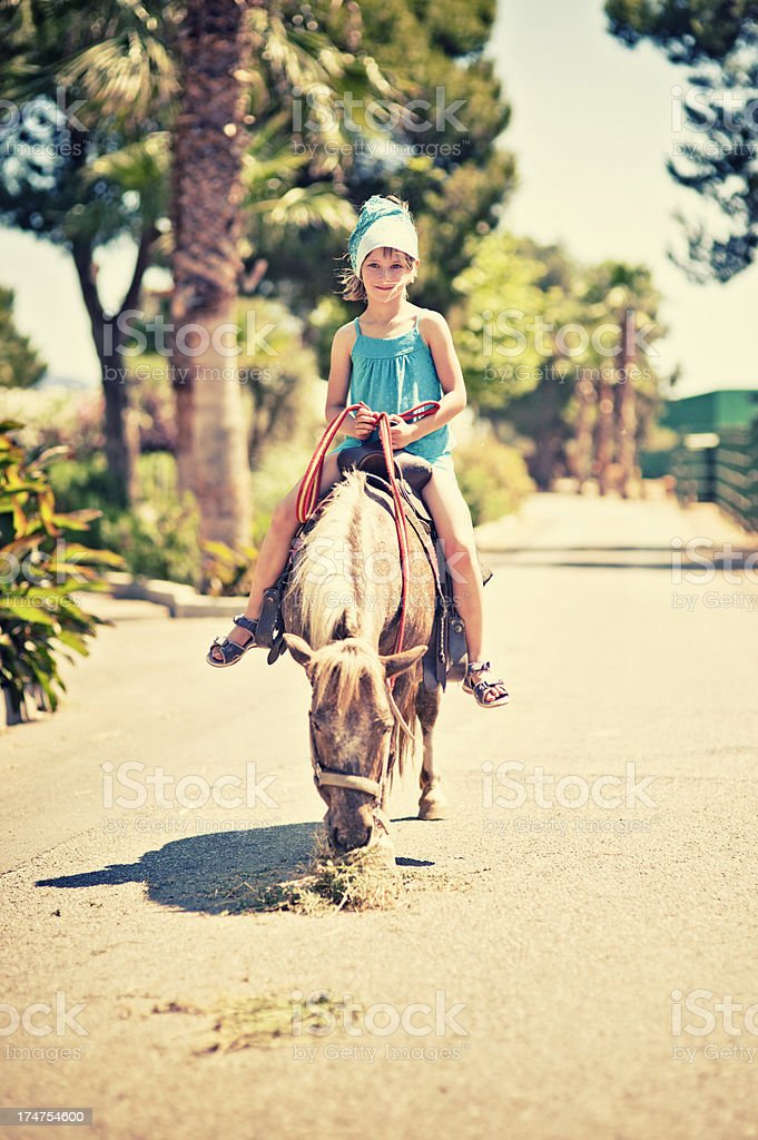 Little ‏girl and her pony royalty-free stock photo