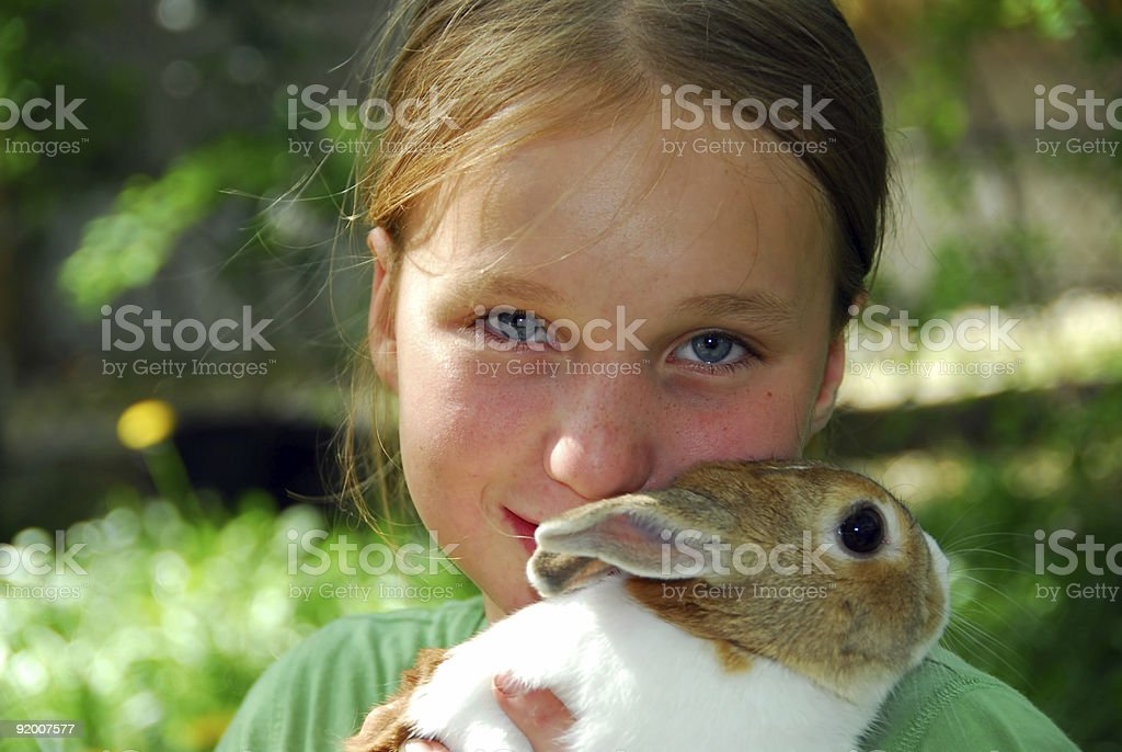 A little girl and her wonderful rabbit royalty-free stock photo