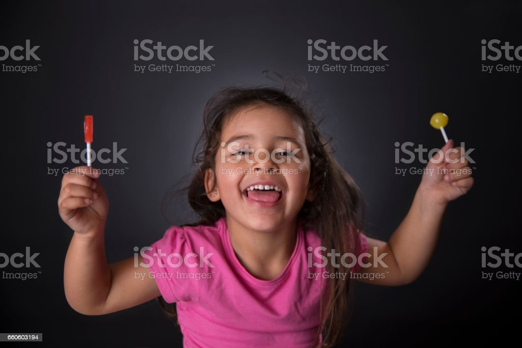 Little girl and lollipop royalty-free stock photo