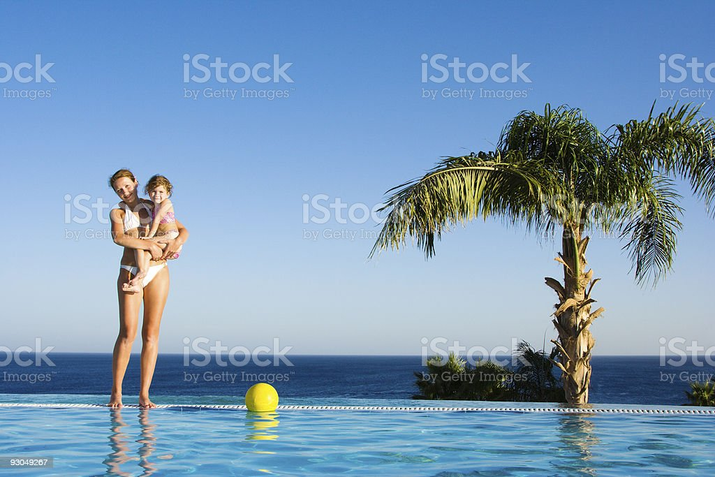 Little girl and mom in pool royalty-free stock photo