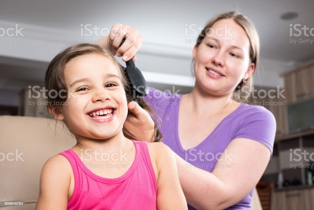 Little Girl and Mother stock photo