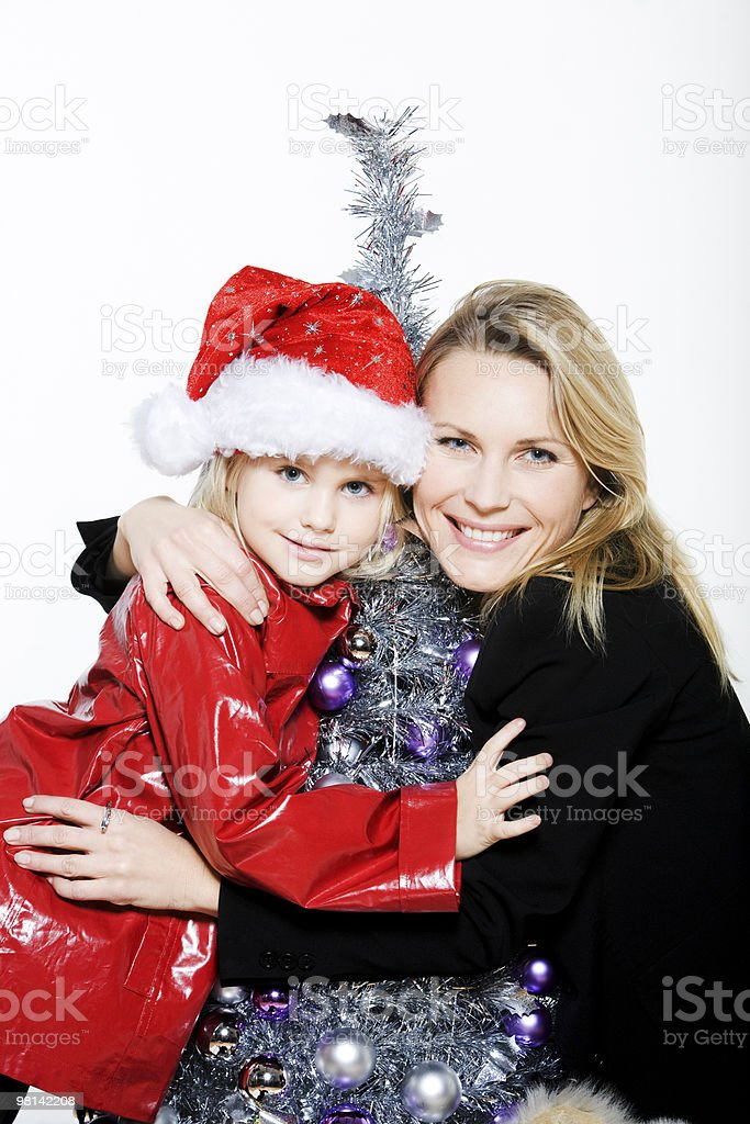 little girl and mother preparing christmas tree royalty-free stock photo