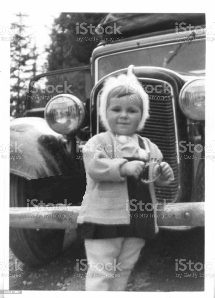 Little girl and old car 1952 stock photo