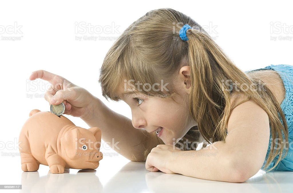 Little girl and piggy bank on white background royalty-free stock photo