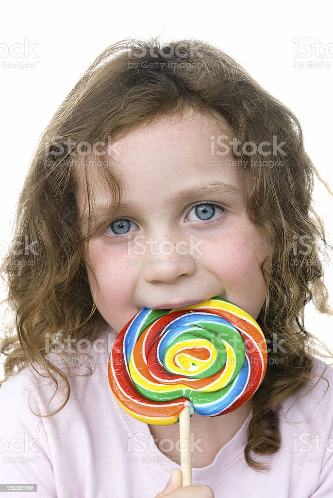 Little girl and pin wheel candy sucker royalty-free stock photo