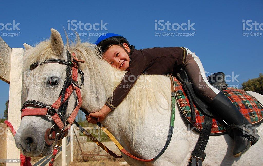 little girl and shetland pony stock photo