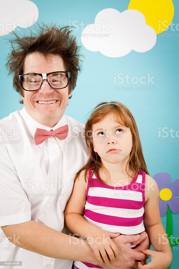Little Girl Annoyed and Embarrassed by Nerdy Dad stock photo