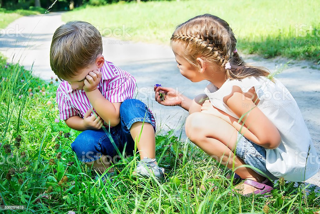 little girl apologizes to offended boy stock photo