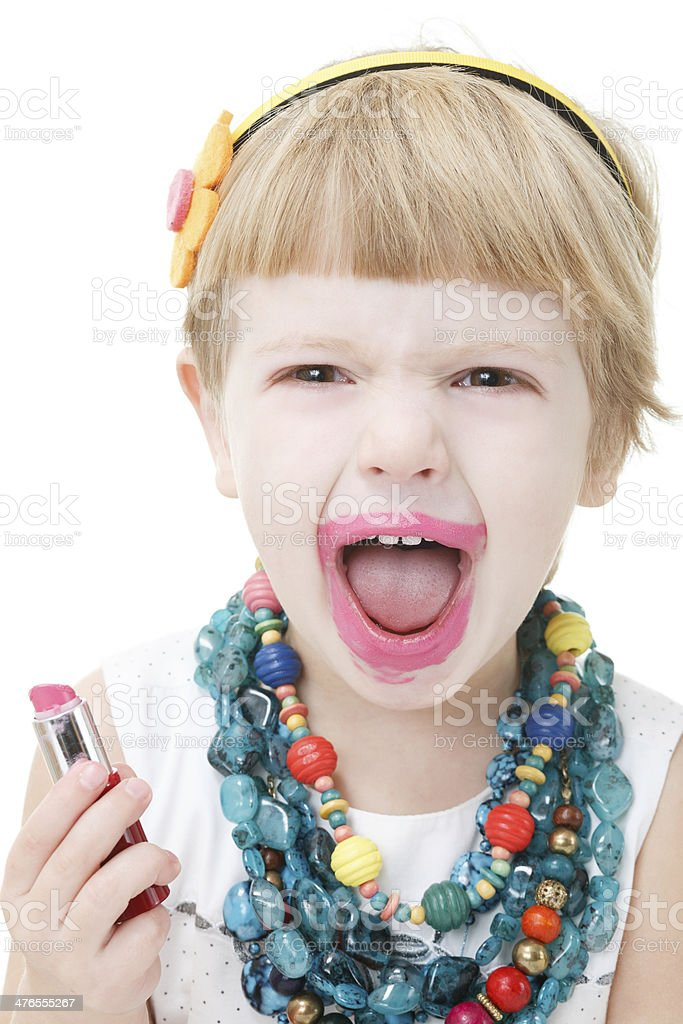 little girl applying lipstick royalty-free stock photo
