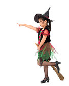 istock Little girl asian in witch costume on Halloween concept. 1169574829