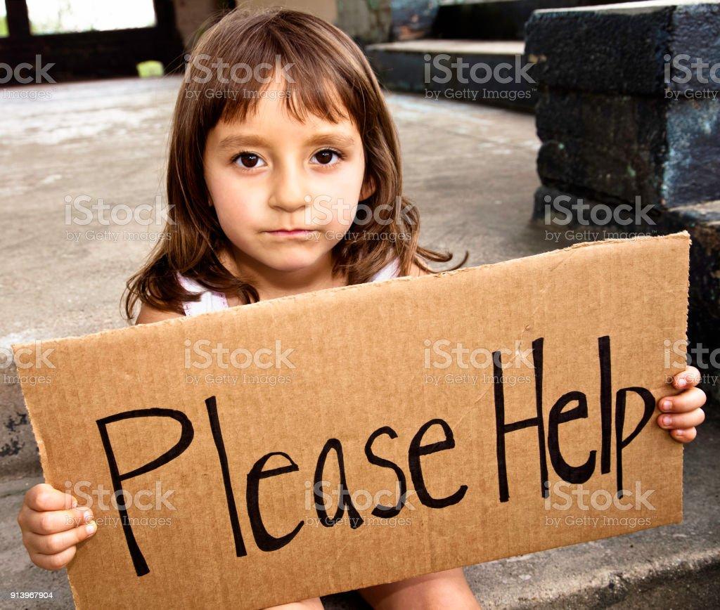 Little girl asking for help stock photo