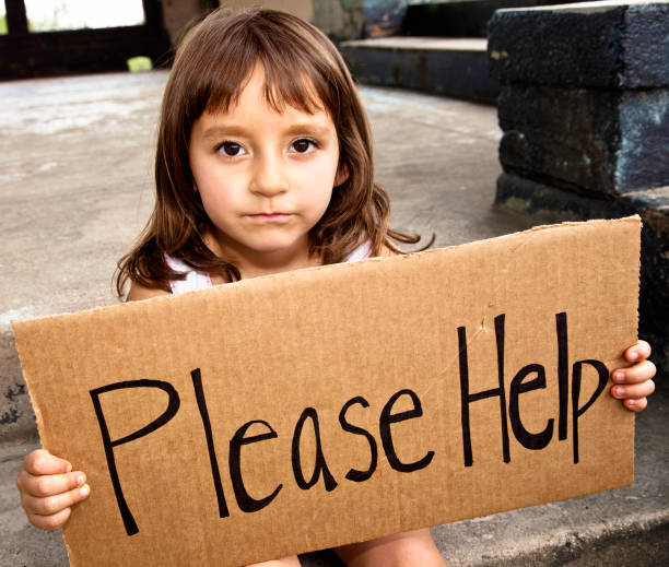 Little girl asking for help Sad preschool age Hispanic girl holds 'Please Help' sign. She has a downcast expression on her face. hungry child stock pictures, royalty-free photos & images