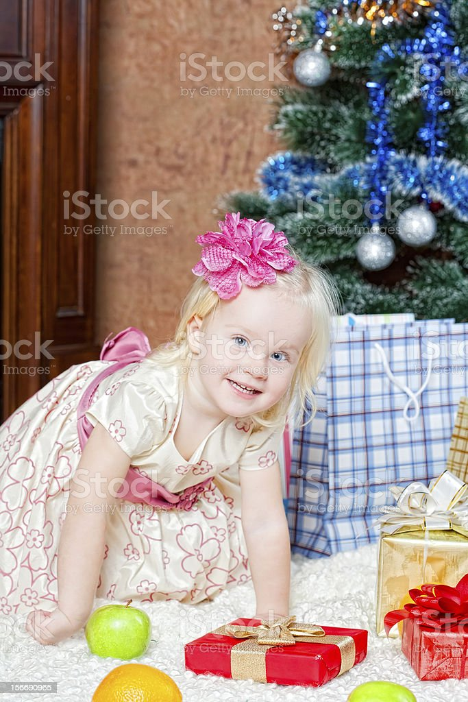 little girl at a Christmas fir-tree royalty-free stock photo