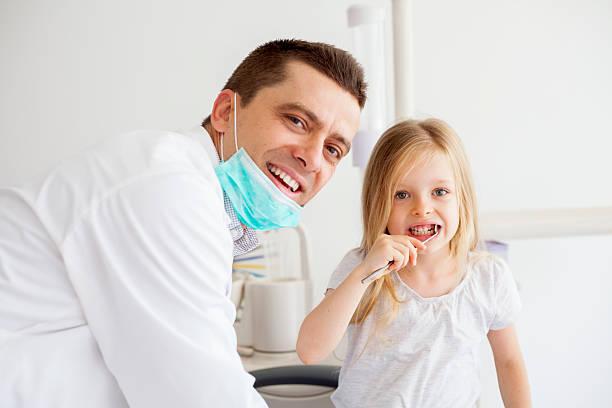 little girl at dentist stock photo