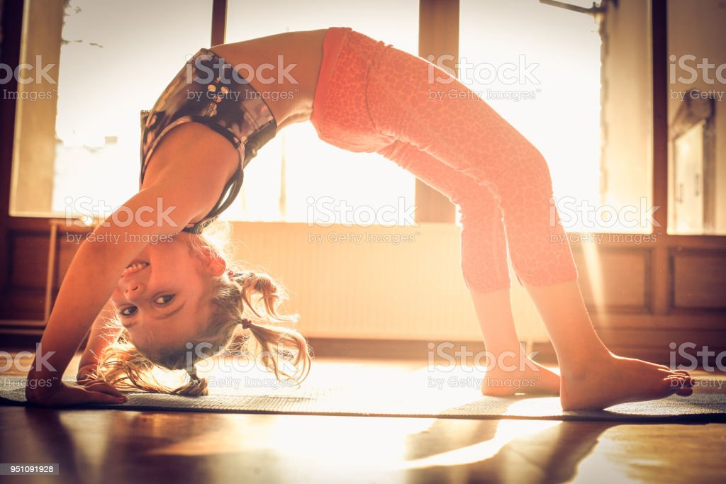 Little girl at gymnastic exercise. stock photo