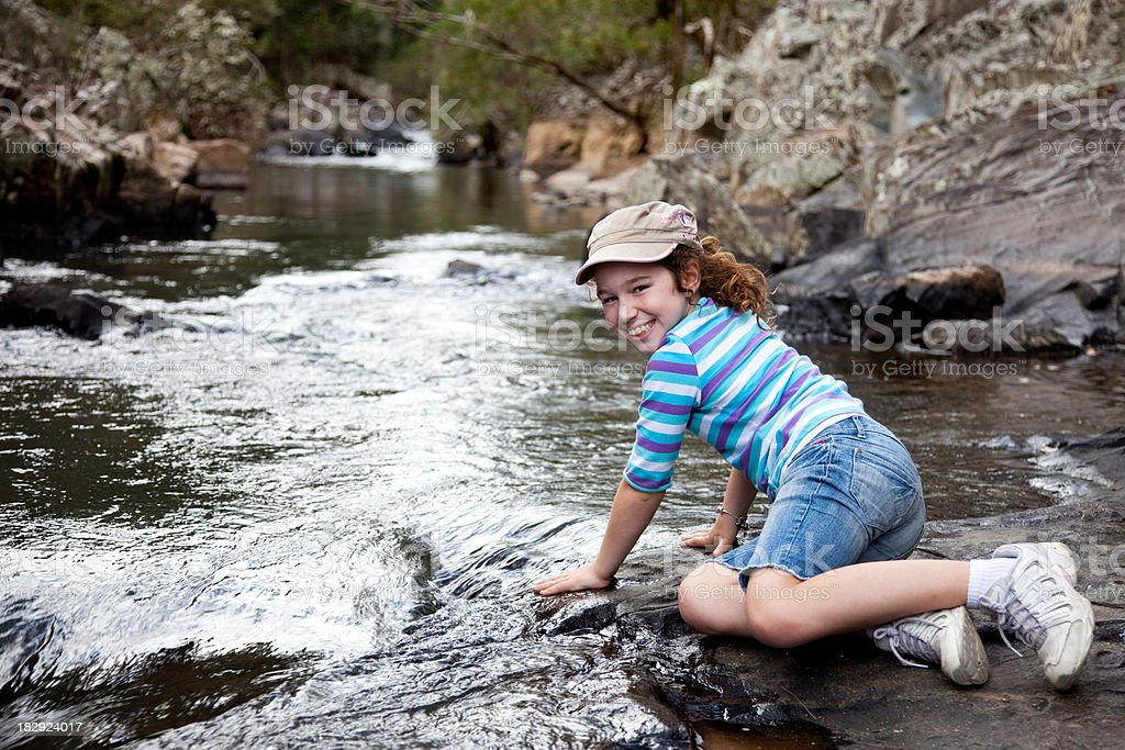 Little girl at rock pool river creek tourist destination stock photo