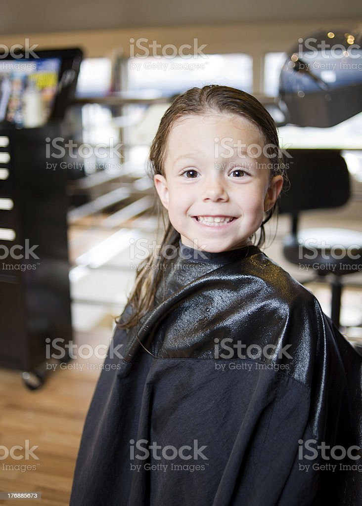 Little Girl at Salon: Getting a Hair Cut and Style royalty-free stock photo