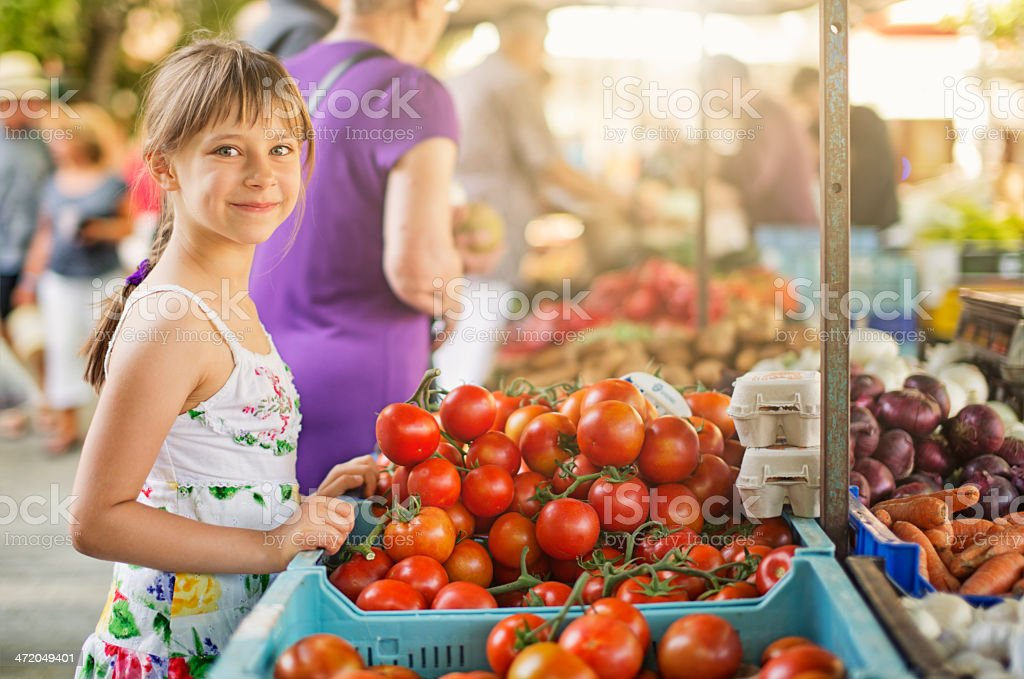 Little girl at the majorcan farmer's market stock photo