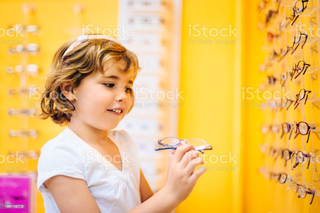 Little girl at the Optician royalty-free stock photo