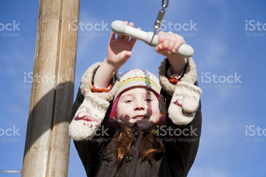 "Little girl at the playground ""Little 7 year old girl, at the playground, ready to take a dive in the deep."" 12 O'Clock Stock Photo"