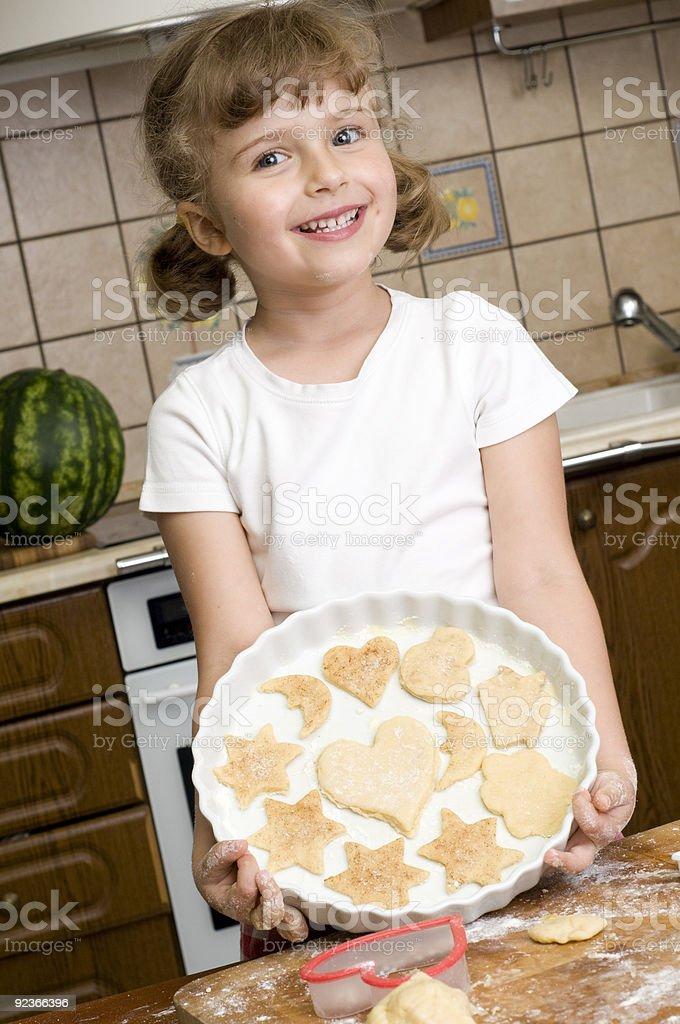 Little girl baking cookies royalty-free stock photo