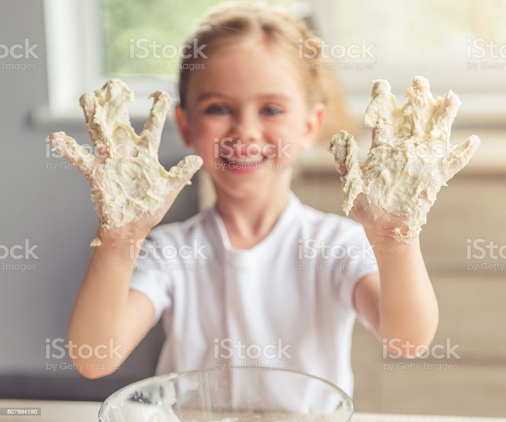 Little girl baking stock photo