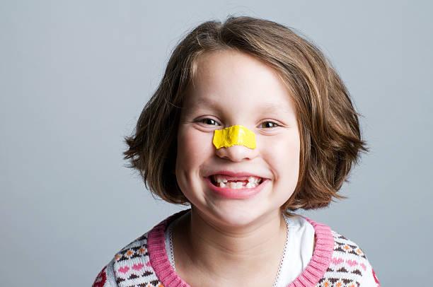 Little Girl, Bandage on Nose stock photo