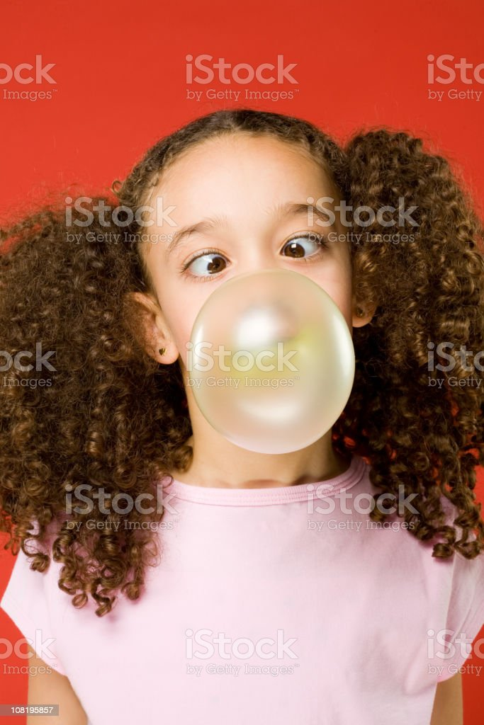 Little Girl blowing a bubble stock photo