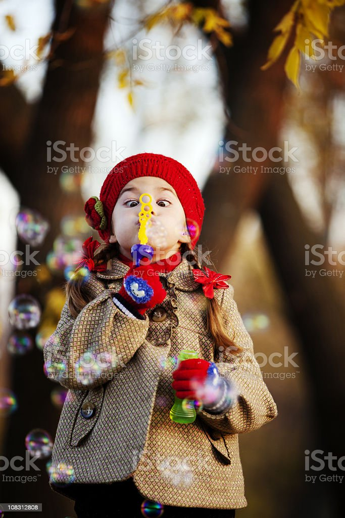 Little Girl Blowing Bubbles royalty-free stock photo