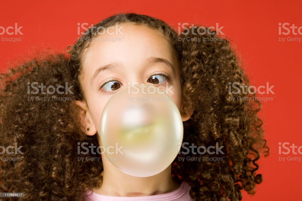 Little girl blows a big bubble stock photo