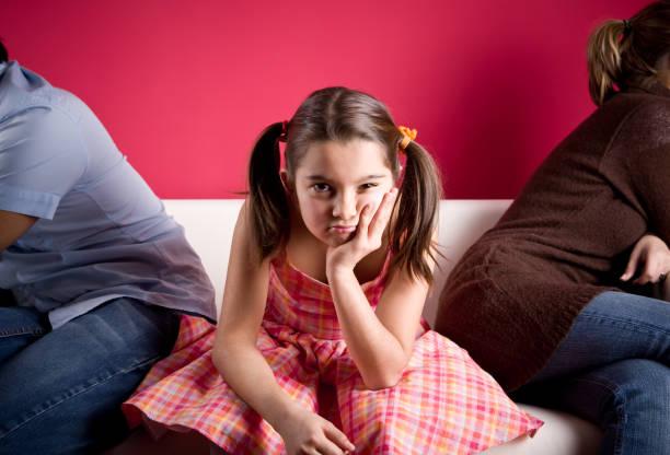 Little Girl Bored in Family Gathering stock photo