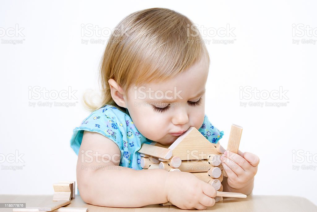 Little girl building house royalty-free stock photo