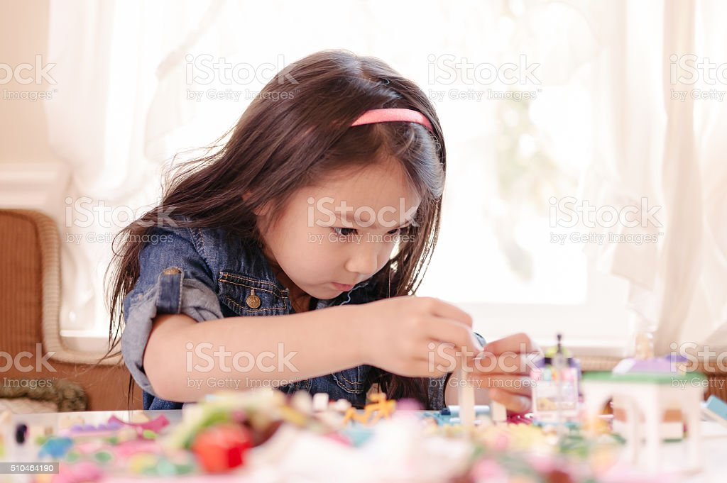 Little girl building something with her LEGO - Royalty-free 6-7 Years Stock Photo