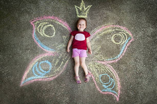 little girl butterfly, joy - chalk drawing stock photos and pictures