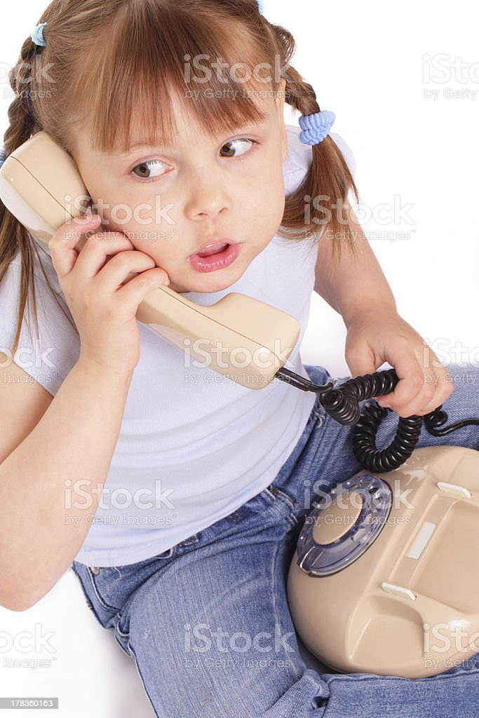 Little girl calling the old phone stock photo