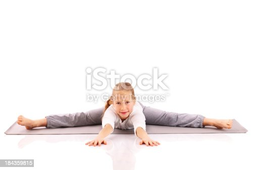 466300721 istock photo Little girl carries out gymnastic exercises. 184359815