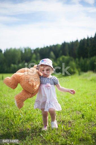 istock Little Girl Carrying Teddy Bear 545114302