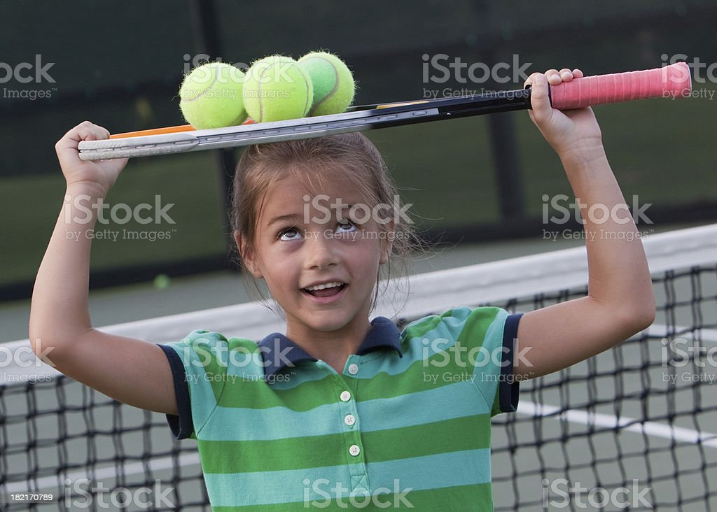 Little Girl Carrying Tennis Balls royalty-free stock photo