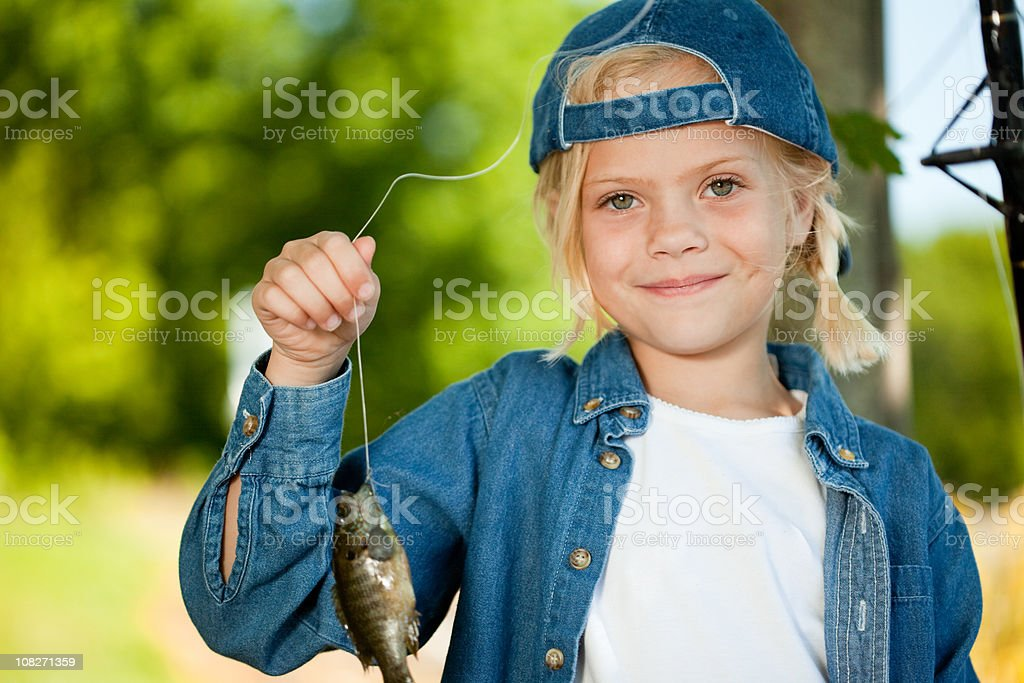Little Girl Caught a Fish royalty-free stock photo