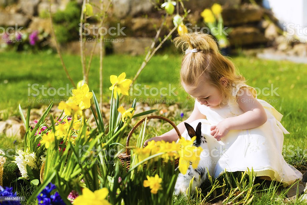 Little girl celebrating Easter with her bunny stock photo