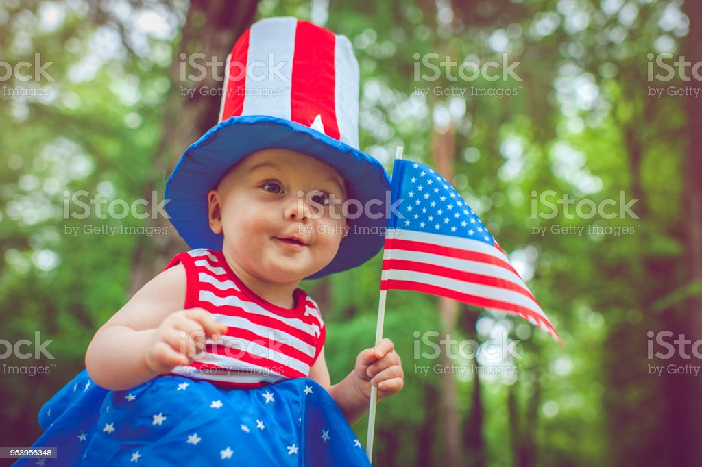Little girl celebrating Fourth of July stock photo
