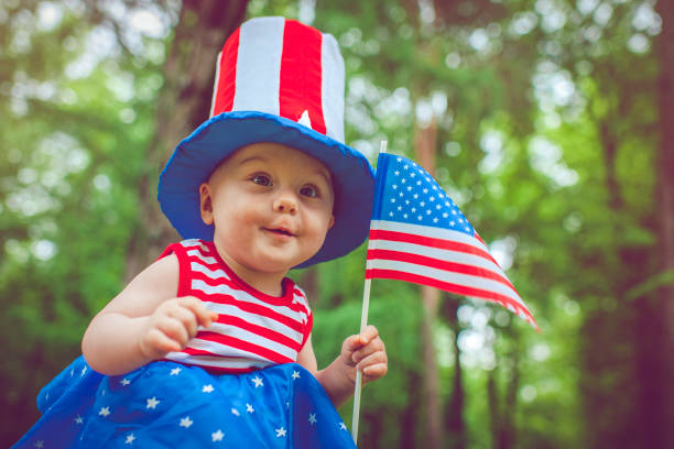 Little girl celebrating Fourth of July stock photo