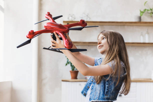 Little girl child with drone at home stock photo