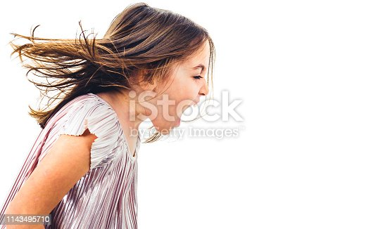 Little girl child yelling, shouting and screaming with bad manners. Angry upset girl is arguing with emotional expression on face. Frontal profile view of children. Isolated on white background.