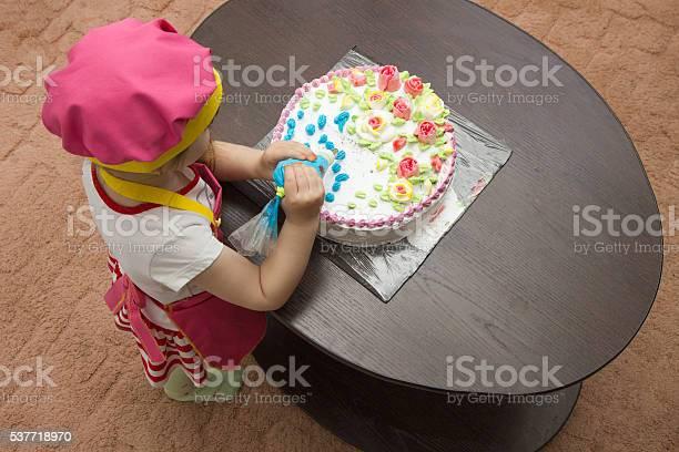 Little Girl Children Decorate Cream Cake Stock Photo - Download Image Now
